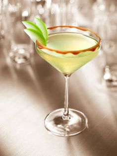 Kissed Caramel (2 oz. Smirnoff Kissed Caramel Flavored Vodka  1½ oz. apple juice  ¼ oz. lemon juice  ¼ oz. simple syrup  Garnish: apple slices)