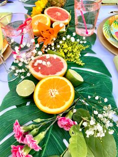 Tropical Flamingo Dinner Party #flamingo #flamingoparty #tropical #pineapple #partydecor #palmleaves #tablescape
