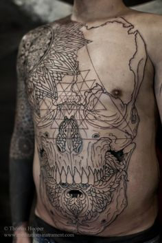Crazy lineal skull depiction with floral and geometric patterns in the mix...