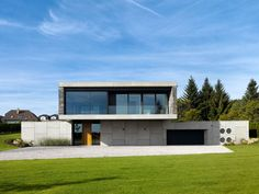 Modern Architecture House Design In Contemporary Era Concrete Two Storey House With Little Wood Combination And Glass Front Wall In Second Floor Concrete House Fence Modern Design Unique Exterior And Interior Design
