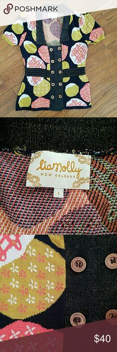 Anthropologie liamolly marimekko L knit sweater Short sleeved dressy sweater from quality knit company liamolly, sold in anthropologie stores countrywide.   Print reminds me of marimekko with its modern bright colors & design.   Fits a L true to size.   Does show some signs of wear, mostly pilling in underarms and a few barely noticeable snags.   Beautiful, beautiful sweater. Anthropologie Sweaters Cardigans