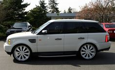 Range Rover with white rims.