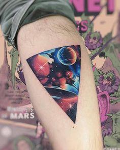 Space UFO triangle tattoo on the calf.
