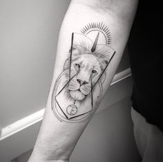 Lion on forearm by Balazs Bercsenyi