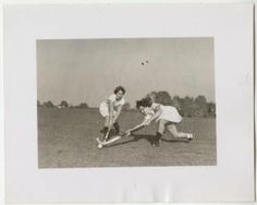 Two students playing field hockey :: Archives & Special Collections Digital Images :: 1951