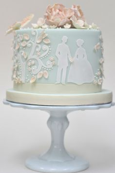 We love the bride and groom silhouette in fondant on this light blue wedding cake.