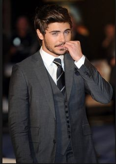sac efron in charcoal grey suit