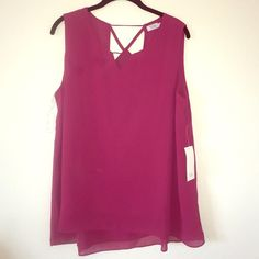 NWT TOBI Cutout Top NEWLY REDUCED PRICE! Brand new raspberry colored TOBI cutout blouse! Top has a small triangle-shaped cutout on the front and a more detailed cutout pattern on the back. This blouse has been kept clean and in great condition, and comes from a pet-free and smoke-free home! Reasonable offers will be considered! Cross posted Tobi Tops Blouses