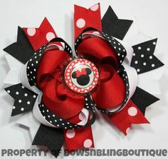 """I love this super cute minnie mouse inspired hair bow! The bow is layered with vibrant colors and beautiful ribbon. Each bow pictured measures approximately 4.5""""- 5"""" across. It is perfect for babies,"""