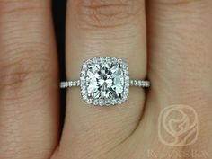 This engagement ring is designed for those who love simple with a slight twist. The cushion cut in the center is traditional while the cushion halo gives it a little bit of interest without being too simple. All stones used are only premium cut, fairly traded, and/or conflict-free! Our