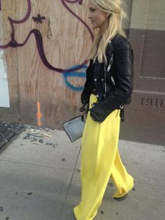 Toughen up sunny wide leg pants with a leather moto jacket. Marie Claire's Zanna Roberts Rassi in Tibi silk wide leg pants.