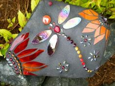 This goes beyond painted rocks.  Adding beads makes the rocks a very special paperweight.