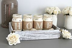 This is a custom designed & hand-painted set of 4 or 5 pint size Mason Jars wrapped in burlap to spell out any 4 or 5 letter word . The one on