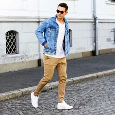 Street style with a denim jacket white t-shirt tan chinos with white sneakers and sunglasses #menswear #menstyle #streetwear #denimjacket #whitesneakers #mensfashion #casualfashion #casual