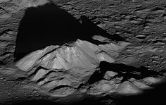 Sunrise at Tycho - Tycho crater's central peak complex casts a long, dark shadow near local sunrise in this spectacular lunarscape. It is about 9.32 miles (15 km) wide with the summit of its central peak reaching 1.24 miles (2 km) above the Tycho crater floor