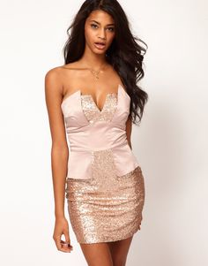 I'm thinking this for NYE...Strapless Peplum Dress in Sequin