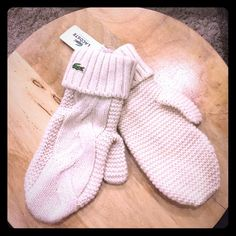NWT Lacoste soft wool knit mittens in cream Adorable knit mittens by Lacoste in a nice cream color. Still with tags attached. Retails for $48. Size medium (my hands are pretty small and they are only a little big so for any regular sized hand- obviously has stretch to it) a really nice gift to give to yourself ;) Lacoste Accessories Gloves & Mittens