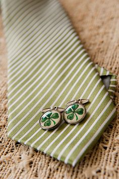 Emerald Cufflinks with a lucky charm