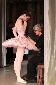 Ballerina having detail work done on her tutu.
