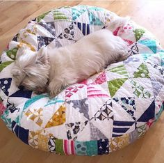 I need some poufs in my life. (Made with this free tutorial: http://tips.allpeoplequilt.com/basics/use-scraps-as-stuffing/)