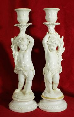 A pair of Cherub Candle Holders - Possibly Minton & Hollins, dated 1871