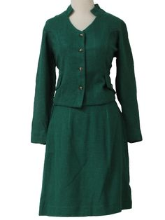 60s -Marcitta- Womens emerald green burlap textured woven acrylic blend long sleeve two piece mod suit dress. The jacket is split cuffs and a princess seams, faux pocket flaps with silvertoned ridge textured buttons, and four button front closure. The slightly flared skirt has a banded waist with left side button and metal zip closure.