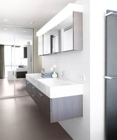 Modern bathroom with floating double sink design in white and gray  I would use a Different mirror