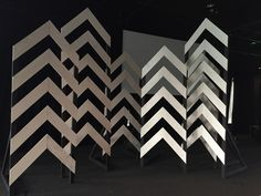 Chevron wooden pattern for church stage design. Change the look with lighting