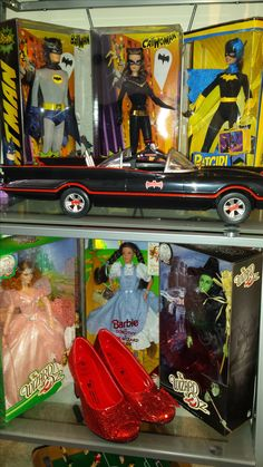 My Barbie Collection in boxes(Never Opened) as of May 2017.  DC Characters: Batman; Catwoman; and Batgirl.  Wizard of OZ Characters: Glinda; Dorothy; Wicked Witch of The West.