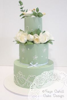 With sugar bird toppers, peonies and foliage.