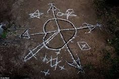 In St Yves, a Veve (a religious symbol commonly used in Voodoo) is created with flour on the ground preceding a ceremony St Yves, Voodoo Rituals, Fertility Problems, Religious Symbols, Voodoo Dolls, Tribal Art, Black Magic, Picture Show, Mystery