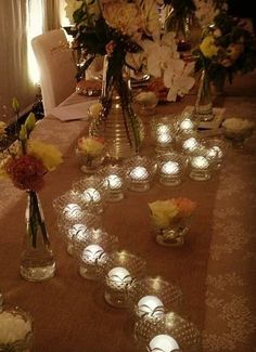 Decorate your table with some pretty tea lights and glass bowls for the perfect dinner ambiance.