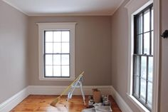 For the walls, I chose Benjamin Moore's Old Soul (CSP-65) in matte from the new Color Stories line, which looks almost beige on the swatch but is really a rich, warm gray. For the trim, I selected BM Linen White in an eggshell finish