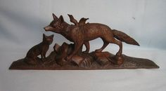 Greatly Detailed Antique Black Forest Hand Carved Mother Fox with Kit . So nice...Photo via Ebay.