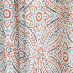 A super pretty, block print inspired, Kelly Ripa Home fabric with a hand painted feeling . The colours are spiced coral orange, sand, teal blue and grey on cream. Perfect for upholstery, roman shades, pillows and home decor projects.