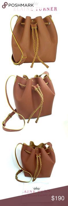 """Elaine Turner Saffiano Bucket Bag-Offers Welcome! Brand new with tags. This gorgeous Elaine Turner Saffiano Leather Bucket Bag is a spring/ summer must have! Features an adjustable shoulder strap (12.5"""" drop); Braided drawstring top closure; embossed signature logo at top centre. The bag is unlined Saffiano leather. Gold metallic interior with contrasting green edge paint. Measurements: 11.3""""H x 9.3""""W x 4.5""""D. Color: Camel. Reasonable offers will be accepted :) Elaine Turner Bags"""