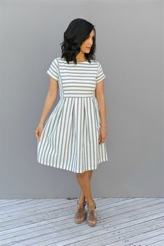 Our Chambray Stripe pleated Dress are oh so stylish. Pockets, knee length and has a side zipper for easy fitting.