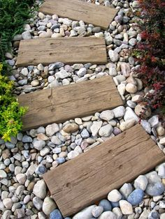 log sleepers, path to fire pit, sleeper doesn't need to be full width, just enough to stop pebbles slipping.