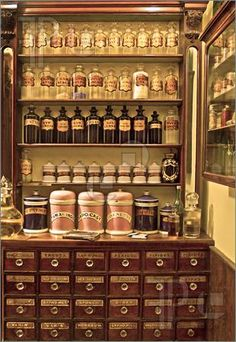 Image of Old laboratory cabinet with lot of jars