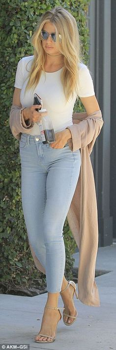 Chic: Charlotte had looked stylish in a figure-hugging, white T-shirt, coupled…