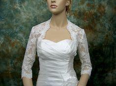 Ivory 3/4 sleeve bridal shrug lace bolero wedding bolero jacket - made of alencon lace. $79.99, via Etsy.