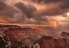 I am just back from a photography adventure, we had amazing weather, the only place where we got rain was at sunset  at the north rim of the grand canyon. Storm clouds, Rainbow and warm sunlight at sunset all came together to create this dramatic scene at the Cape Royal viewpoint on the North Rim of Grand Canyon national Park in Arizona
