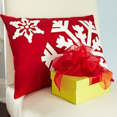 Felt Snowflake Pillow  Craft your own snowy scene by sprinkling a dusting of snowflakes across a red felt pillow. Trace the snowflake patterns onto sheets of fusible webbing, fuse to ivory felt, cut out the shapes, and then fuse to a pillow front. For a decorative touch, use a sewing machine and rayon thread to add topstitch details.  Get the snowflake patterns.