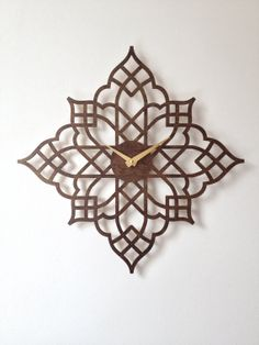 Each clock is made to order by Sarah Mimo, laser cut from premium baltic birch plywood, stained and finished by hand, and equipped with a high Wooden Clock, Wooden Art, Laser Cut Wood, Laser Cutting, Rose Clock, Ideas Joyería, Wall Watch, Displays, Cool Clocks
