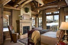 Master retreat by Locati Interiors.  Wood beam ceiling.  Rustic timbers. Stone fireplace.  Window treatments. Mountain lodge. Ski resort.