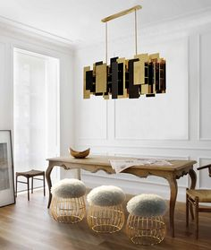 For our Fo Tan Suspension Lamp, we've lacquered the several brass elements in copper, gold and oxy black. The nickel finish is a mirror where the light shines warmth.