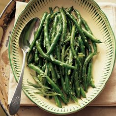 These green beans are prepared simply -- cooked with butter, shallots, and white wine. Tarragon is stirred into the finished dish.