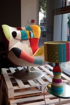 No to the lamp but SOO yes to the chair - looks comfy to curl up & read in. Fun funky furniture