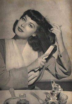 Ava Gardner ... brushing her hair
