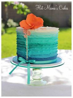 The ruffles were colored to resemble the ocean and the coral colored Hibiscus flower to tie the tropical theme together